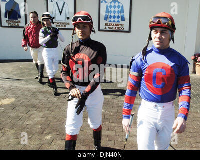 Mar 02, 2008 - South Ozone Park, Queens, NY, USA - CAROL CEDENO (C), surrounded by other jockeys, enters the paddock. - Stock Photo