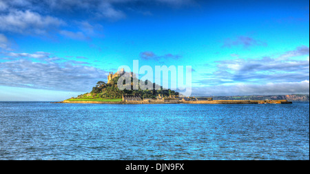 Medieval castle on island St Michaels Mount Cornwall England with vivid Cloudscape in HDR like painting - Stock Photo