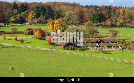An English Rural Landscape in Autumn in the Chiltern Hills with Farmhouse and equestrian area - Stock Photo