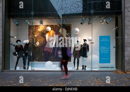 The front of New Look store, passers-by & facade sign, Liverpool, Merseyside.  'New Look' Liverpool One city centre - Stock Photo