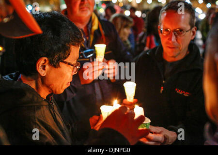 San Francisco, California, USA. 27th Nov, 2013. People light candles preceding a march that was held to mark the - Stock Photo