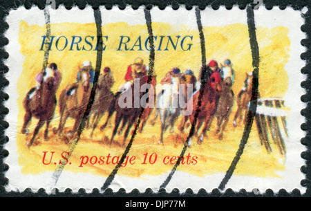 The 100th anniversary of racing on horseback 'Kentucky Derby' shows Horses Rounding Turn - Stock Photo