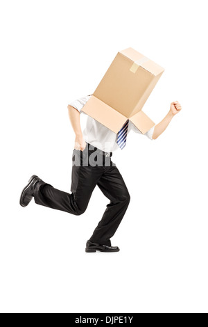 Full length portrait of a guy with a cardboard box on his head running away - Stock Photo