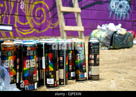 Set of other type of spray cans used at the event, with one bag used by an artist at the event in Cartago. - Stock Photo