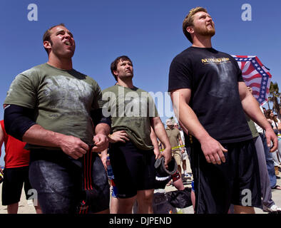 March 27, 2010 - Huntington Beach, California, USA -  Competitors watch the keg toss, one of six disciplines in - Stock Photo