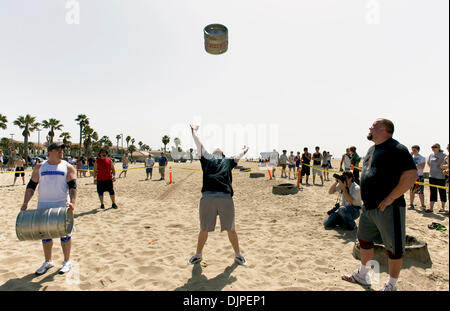 March 27, 2010 - Huntington Beach, California, USA -  Competitors practice the keg toss, one of six disciplines - Stock Photo