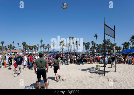 March 27, 2010 - Huntington Beach, California, USA -  Competitors practice prior to the keg toss, one of six disciplines - Stock Photo