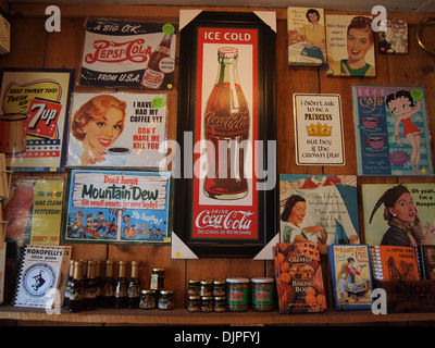 Various vintage advertisement signs on display at the Gold King Mine gift shop in Jerome, Arizona, USA - Stock Photo