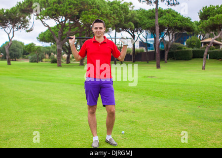 Young man on the golf course - Stock Photo
