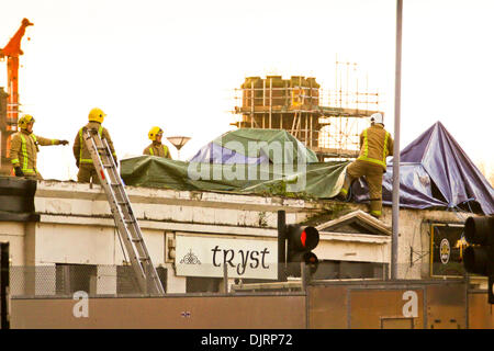 Glasgow, Scotland, UK. 30th November 2013.  St. Andrews Day dawns with rescue workers continuing to work at scene - Stock Photo