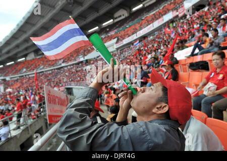 Bangkok, Thailand. 30th Nov, 2013. A red-shirt supporter blows a trumpet during a rally in Bangkok, Thailand, Nov. - Stock Photo