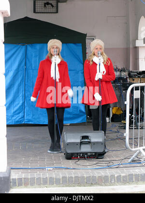 Godalming, Surrey, UK. 30th November 2013. Singers in Christmas attire entertain passers-by at the annual Christmas - Stock Photo