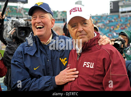 NCAA Gator Bowl - Bobby Bowden and West Virginia's head coach exchange war stories at midfield before the start - Stock Photo