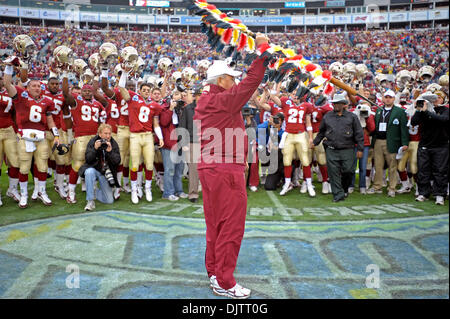 NCAA Gator Bowl - Bobby Bowden prepares to plant FSU's flaming spear to the delight of his team before the start - Stock Photo