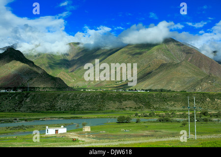 Landscape viewed from train of Trans-Tibetan Railway, Tibet, China - Stock Photo