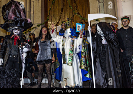 Costumed revelers parade through the streets to celebrate the Day of the Dead Festival known in spanish as Día de - Stock Photo