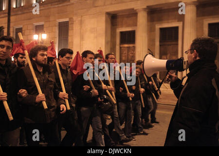 Athens, Greece. 30th November 2013. Antifascist protesters shout slogans during a protest as a response to the one - Stock Photo