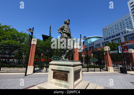 Babe Ruth 'Babe's Dream' statue outside Oriole Park (home of Baltimore Orioles), Hilton Hotel in background, Baltimore, - Stock Photo