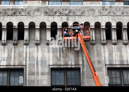 Workers cleaning part of the Bank of America Building, Baltimore City, Maryland, USA - Stock Photo
