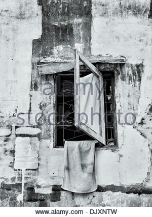 A towel left out to dry in an abandoned apartment block, in the Sathorn district of Bangkok, Thailand. - Stock Photo