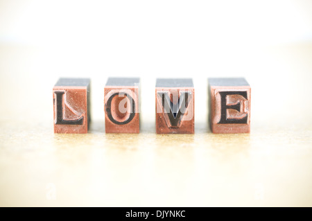 Word 'love' spelled out in letterpress letters. - Stock Photo