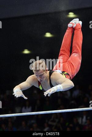 Stuttgart, Germany. 1st Dec 2013.Germany's Fabian Hambuechen at the high bar during the Gymnastics World Cup. Hambuechen - Stock Photo