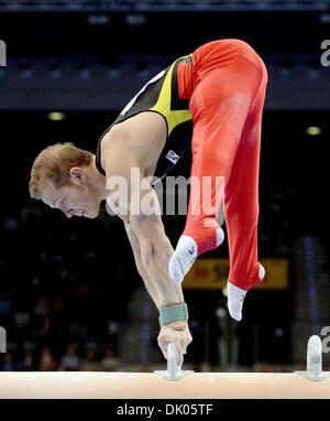 Stuttgart, Germany. 1st Dec 2013.Germany's Fabian Hambuechen at the pommel horse during the Gymnastics World Cup. - Stock Photo