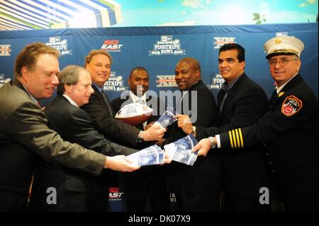 Dec. 22, 2010 - Manhattan, New York, U.S. - LtoR: Mark Holtzman, Exec. Dir. New Era Pinstripe Bowl, Yankee Chief - Stock Photo