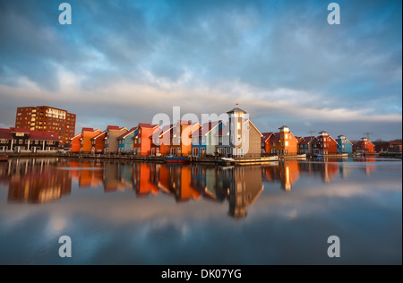 colorful buildings on water during sunrise, Reitdiephaven, Groningen, Netherlands - Stock Photo
