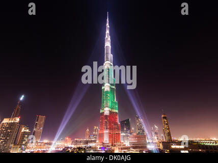Dubai, UAE. 1st Dec 2013. Burj Khalifa Tower floodlit in the white, green and red colours of the flag of the United - Stock Photo