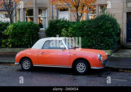 Orange coloured Nissan Figaro car parked in Edinburgh. - Stock Photo