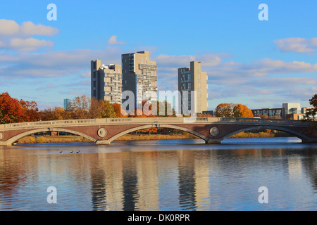 Harvard University owned apartment towers Peabody Terrace and Weeks Footbridge on Charles River in Fall in Cambridge, - Stock Photo