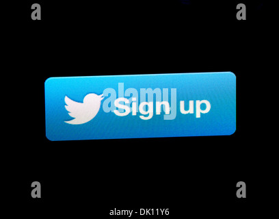 Twitter sign up button on an iPad - Stock Photo