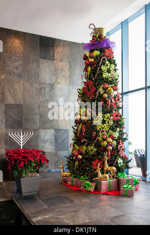 Christmas and Hanukkah decorations, lobby of River House Condominiums along  New River in downtown Fort Lauderdale, - Stock Photo