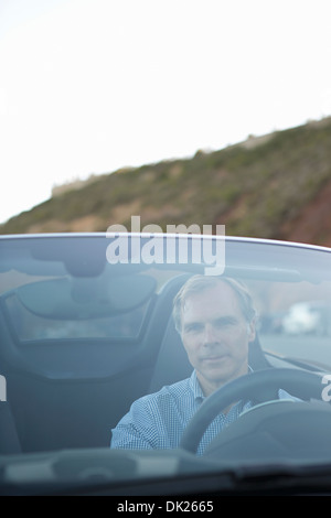 Man driving convertible sports car - Stock Photo