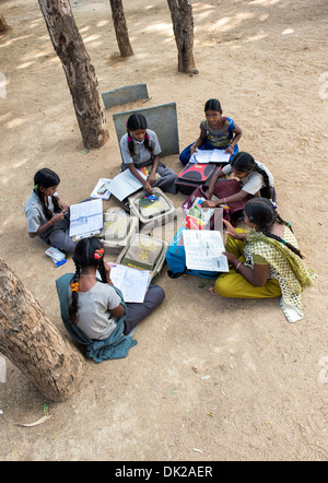 Rural Indian village school girls doing mathematics in an outside class. Andhra Pradesh, India - Stock Photo