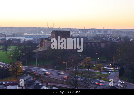 Carlisle Castle with evening traffic passing in front - Stock Photo