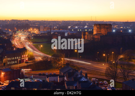 A yellow sunset behind the Castle in Carlisle city centre - Stock Photo