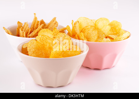 Potato and wheat chips in bowls isolated on gray background. - Stock Photo