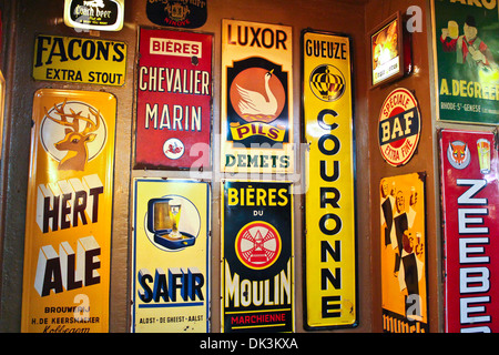 Delirium Cafe - Beer Brewers adorn the Walls of Delirium Cafe in Brussels. - Stock Photo