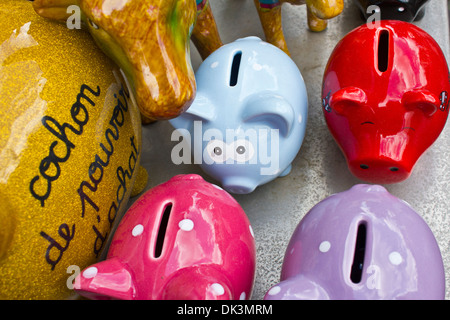 French Piggy Banks in Paris - A View of Colorful Piggy Banks with One in for a Surprise - Stock Photo