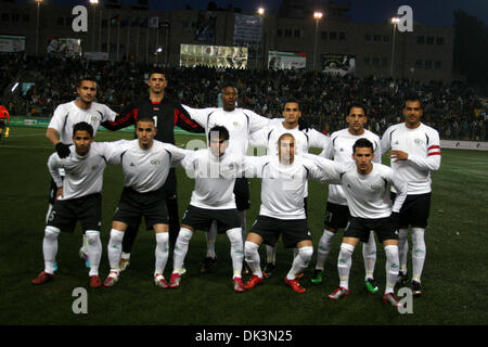 Mar 09, 2011 - Ramallah, West Bank - Palestine's national football players. Palestinian (white) and Thailand  national - Stock Photo