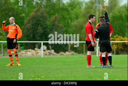 Red card waved by referee for foul play at Foxash football club,Lawford,Essex,UK