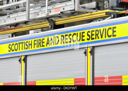 Image of the side of a fire engine with the logo 'Scottish Fire and Rescue Service'. - Stock Photo