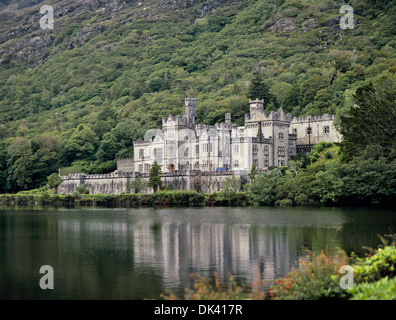 Kylemore Abbey at the base of Druchruach Mountain, Connemara, County Galway, Ireland - Stock Photo