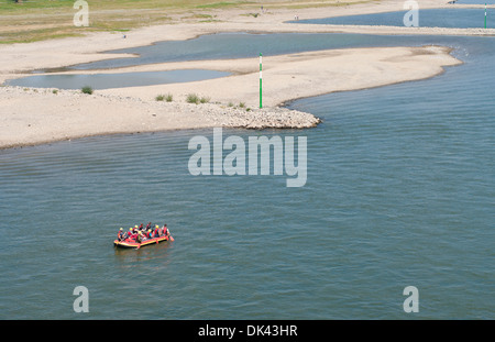 people in a rafting boat on the Rhine at Dusseldorf, Germany - Stock Photo