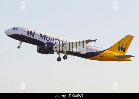 Monarch Airlines Airbus A320-200 climbing after taking off - Stock Photo