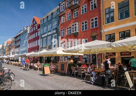 Street Cafes at Nyhavn in Copenhagen, Denmark - Stock Photo