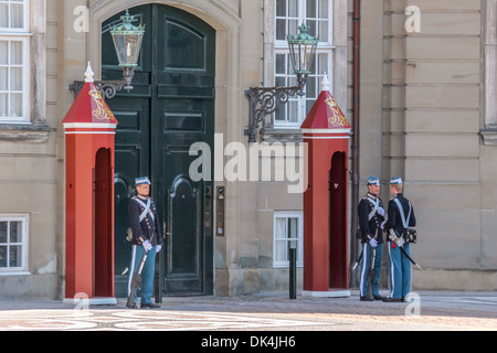 Changing of the guard in front of Amalienborg Palace in Copenhagen, Denmark - Stock Photo