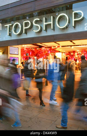 Shoppers outside and inside Topshop clothing store - Stock Photo